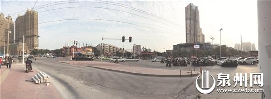 路口增加渠化岛,引导人车分流。