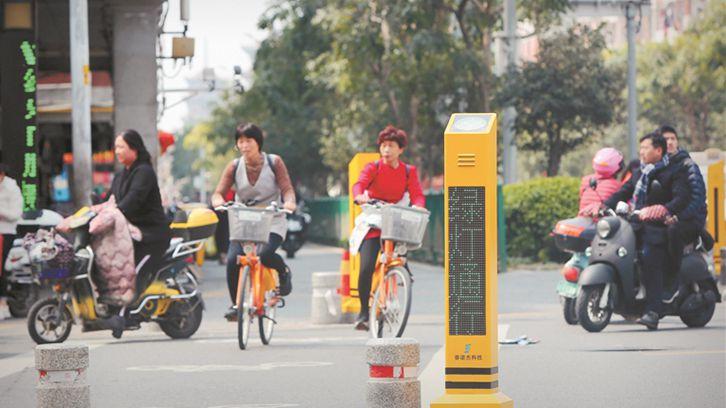 过街语音提示桩在中心市区部分路口试运行